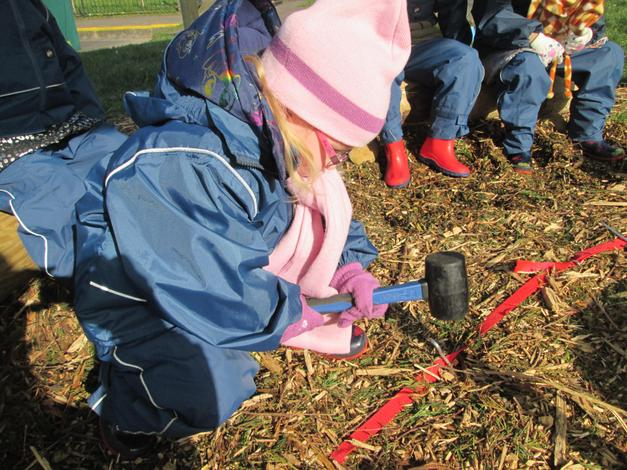 learning how to put in tent pegs.