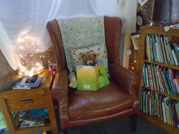Having a quiet read at the Story Barn.