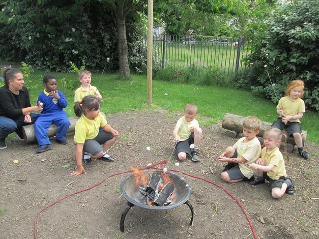 Enjoying marshmallows around the camp fire.