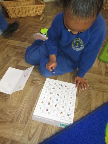 Using our sound mats to help write a card.