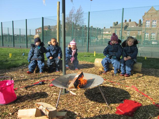 Learning how to stay safe around the fire.