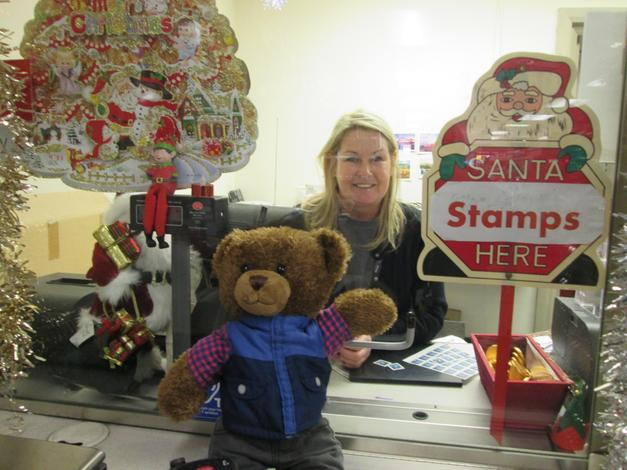 Bradley buying his stamp for his letter to Santa.