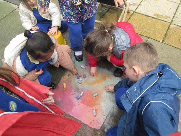 Exploring using chalk on a wet floor after it had been raining.