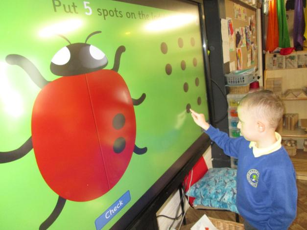 """Developing number recognition and couniting. """"Can you put 5 spots on the ladybird?"""""""