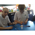 Learning about electric circuits.