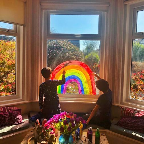 Painting a rainbow on the window