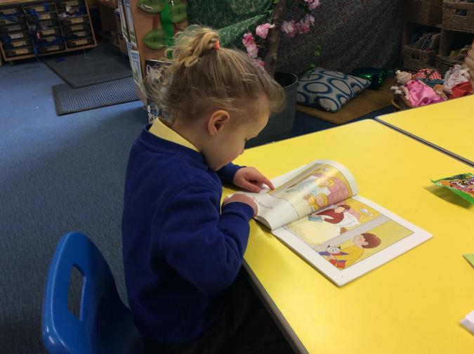 Reading using our phonics.