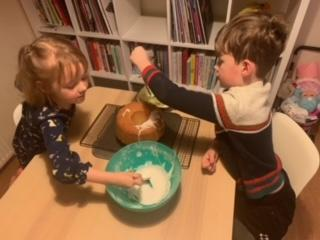 Isobel and brother cooking together