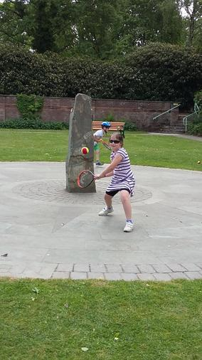 Annabel practising her tennis skills