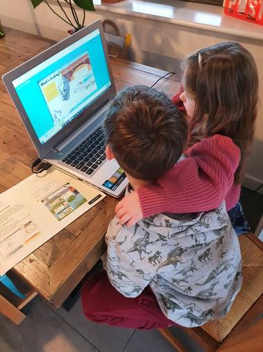 Thomas reading to his sister.