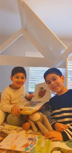 Ishaq has been reading with his little brother
