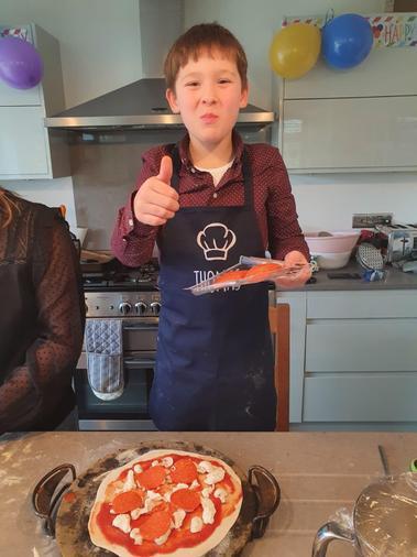 Thomas enjoyed making pizza for his birthday