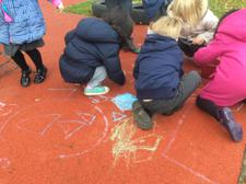 After sharing the story of Elmer the elephant, we drew our own colourful squares outside. 2