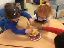We have been learning about Chinese New Year today, finding out about how noodles change when they are cooked, and using chopsticks. We added them to our water tray, too. 6