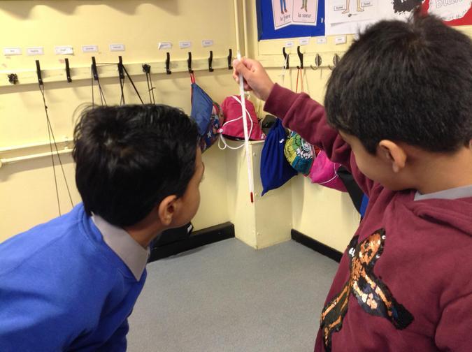 Aadam and Zayaan measuring the classroom temperature