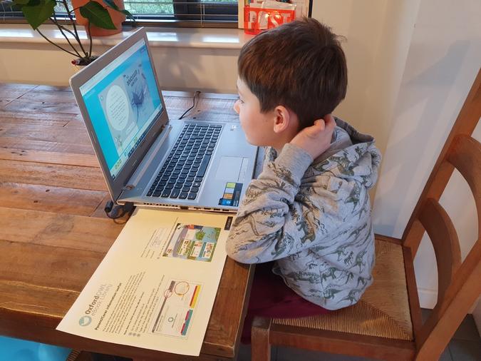 Thomas enjoying an e-book.