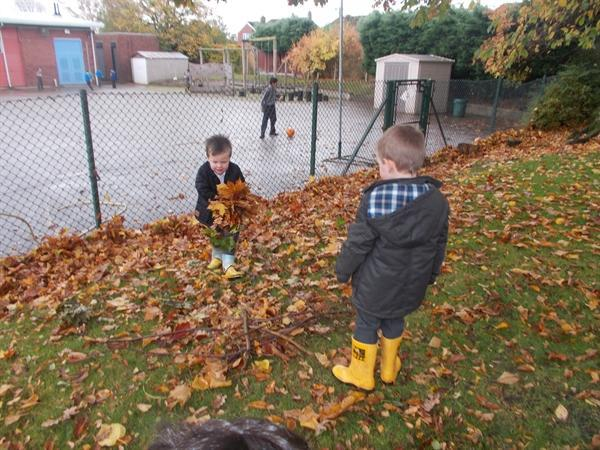 Working together to collect leaves and twigs.