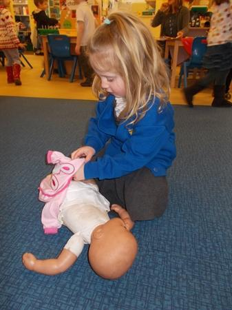 Dressing our dolls.