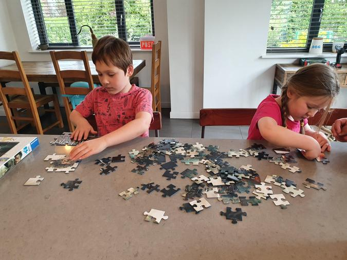 Family fun doing jigsaws