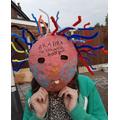 Resmie has been making paper mache masks.