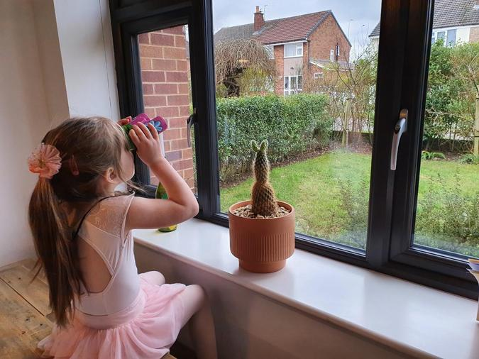 Emily observing and collecting data for the class RSPB