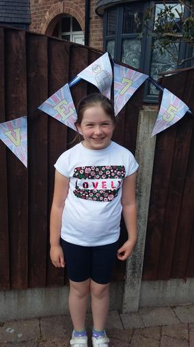 Annabel celebrating VE Day with homemade bunting