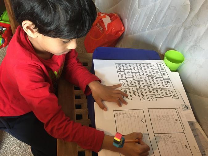 Sameer busily writing