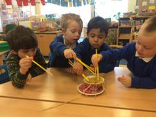 We have been learning about Chinese New Year today, finding out about how noodles change when they are cooked, and using chopsticks. We added them to our water tray, too. 4