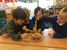 We have been learning about Chinese New Year today, finding out about how noodles change when they are cooked, and using chopsticks. We added them to our water tray, too. 5