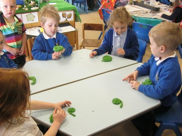 Making snails with playdough.