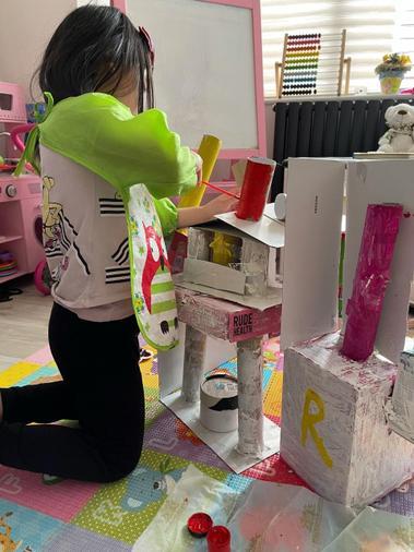 Renee making her building inspired by Zaha Hadid