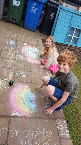 Archie and his sister drawing rainbows