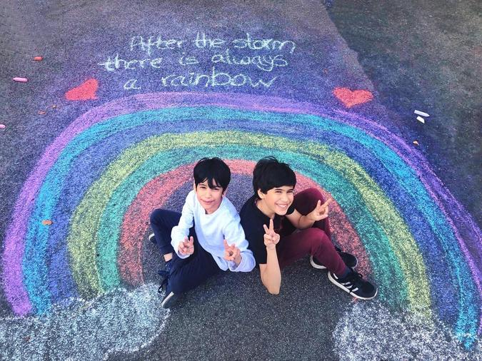 Izyaan and his brother in their driveway