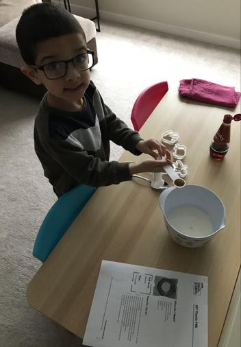 Dylan making bio-plastic from the instructions in our science lesson