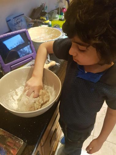 Ali making challah bread from our instructions on cooking around the world-kneading