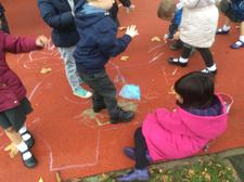 After sharing the story of Elmer the elephant, we drew our own colourful squares outside. 1