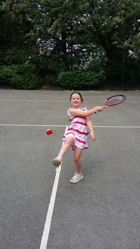 Ros practising her tennis