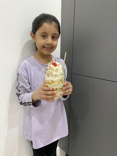 Fatimah enjoying a special valentines treat - yummy!