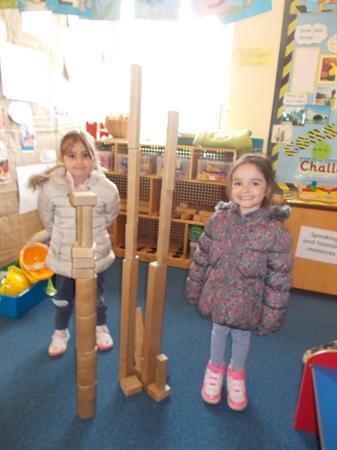 Balancing bricks to build a tower.