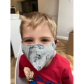 Making her brother a home made mask