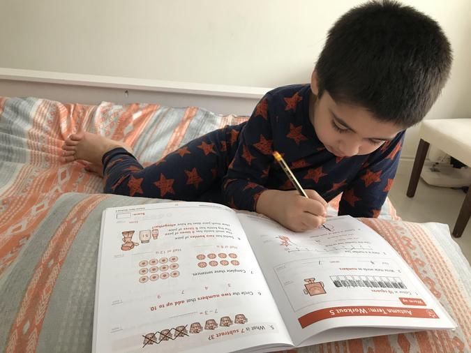 Saad completing his maths work