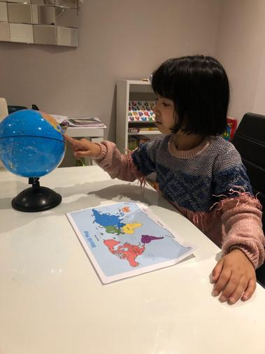 We looked at maps and globes to find Asia (where tigers can be found in the wild).