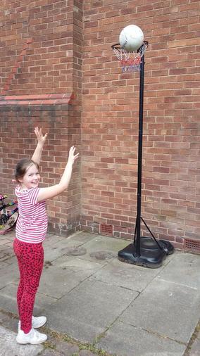 Annabel practising her netball skills