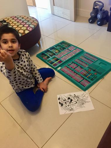 Saad practising his colouring