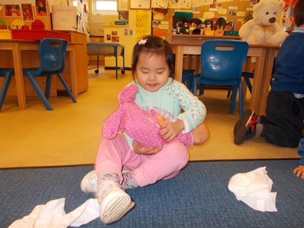 Then we dressed our dolls or toys in baby clothes.