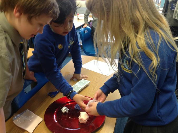 Amber, Aden and Dylan had to check the ice cube wrapped in cling film.