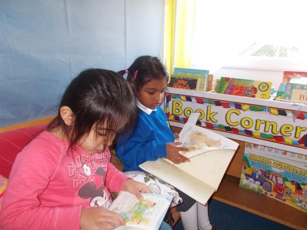 Enjoying books in our reading tent