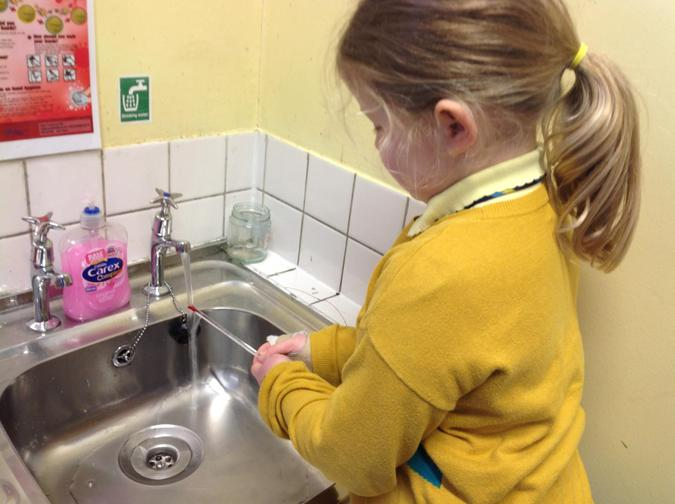 Sophia measuring the temperature of cold water