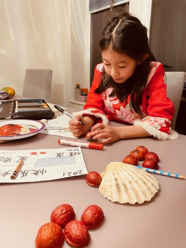 Ella carefully making some Chinese New Year decorations