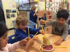 We have been learning about Chinese New Year today, finding out about how noodles change when they are cooked, and using chopsticks. We added them to our water tray, too. 3